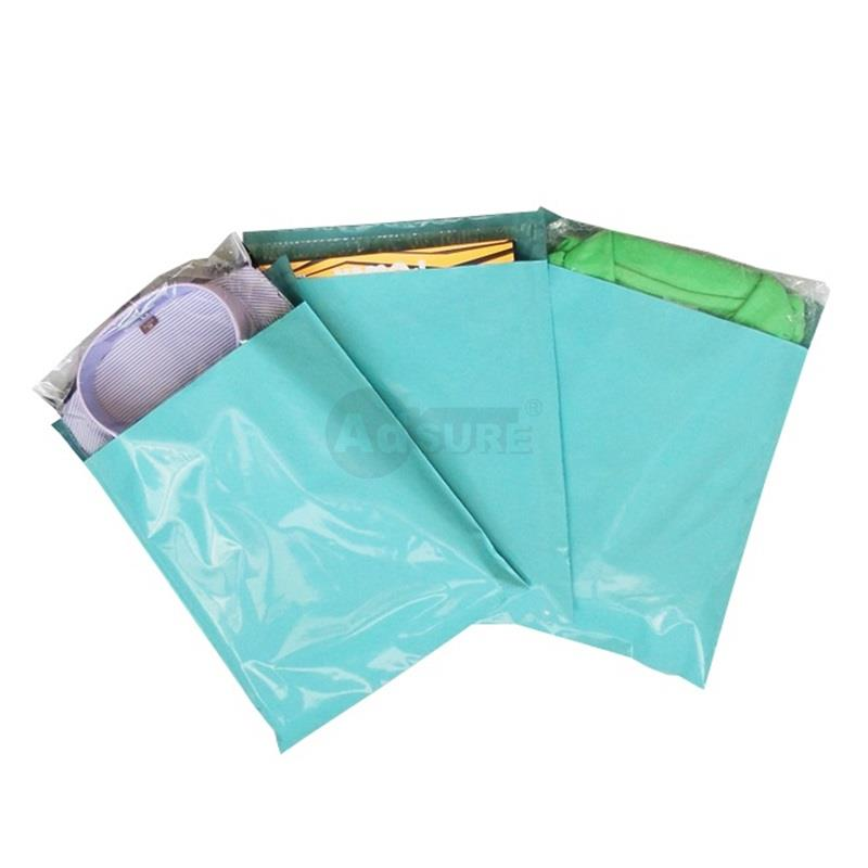 cyan colored plain mailing bags